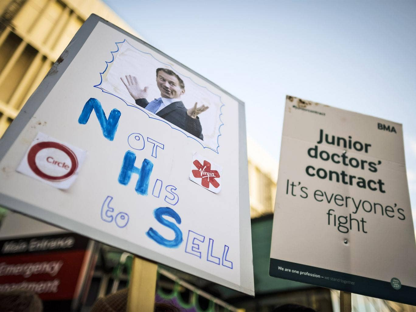 A placard depicting Jeremy Hunt is held up at the picket line outside the Bristol Royal Infirmary PA