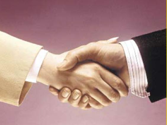 pg55-handshake-alamy.jpg