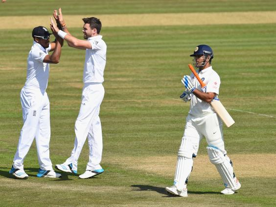 England-bowler-James-Anderson-(r)-is-congratulated-by-Chris-Jordan-after-taking-the-wicket-of-M.S-Dhoni-during-day-four.jpg