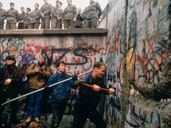 Berlin_Wall_being_smashed_down.jpg