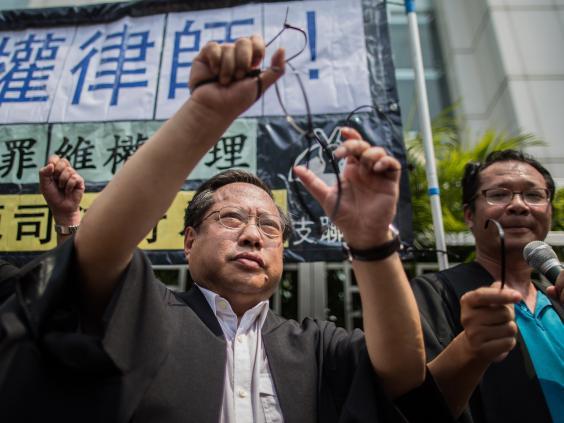 pg-6-human-rights-china-getty.jpg