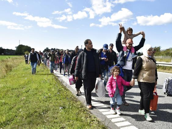 Refugees-walk-Denmark-2.jpg