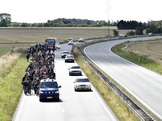 Refugees-walk-Denmark-3.jpg