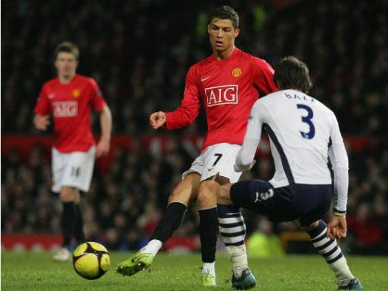 Gareth Bale watches on as Cristiano Ronaldo passes against Tottenham at Old Trafford