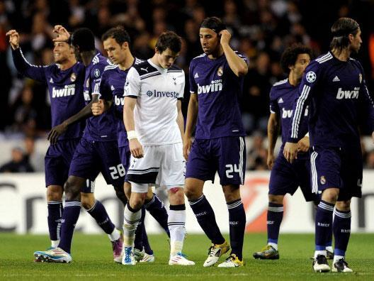 Gareth Bale is dejected as Cristiano Ronaldo is congratulated on his goal at White Hart Lane