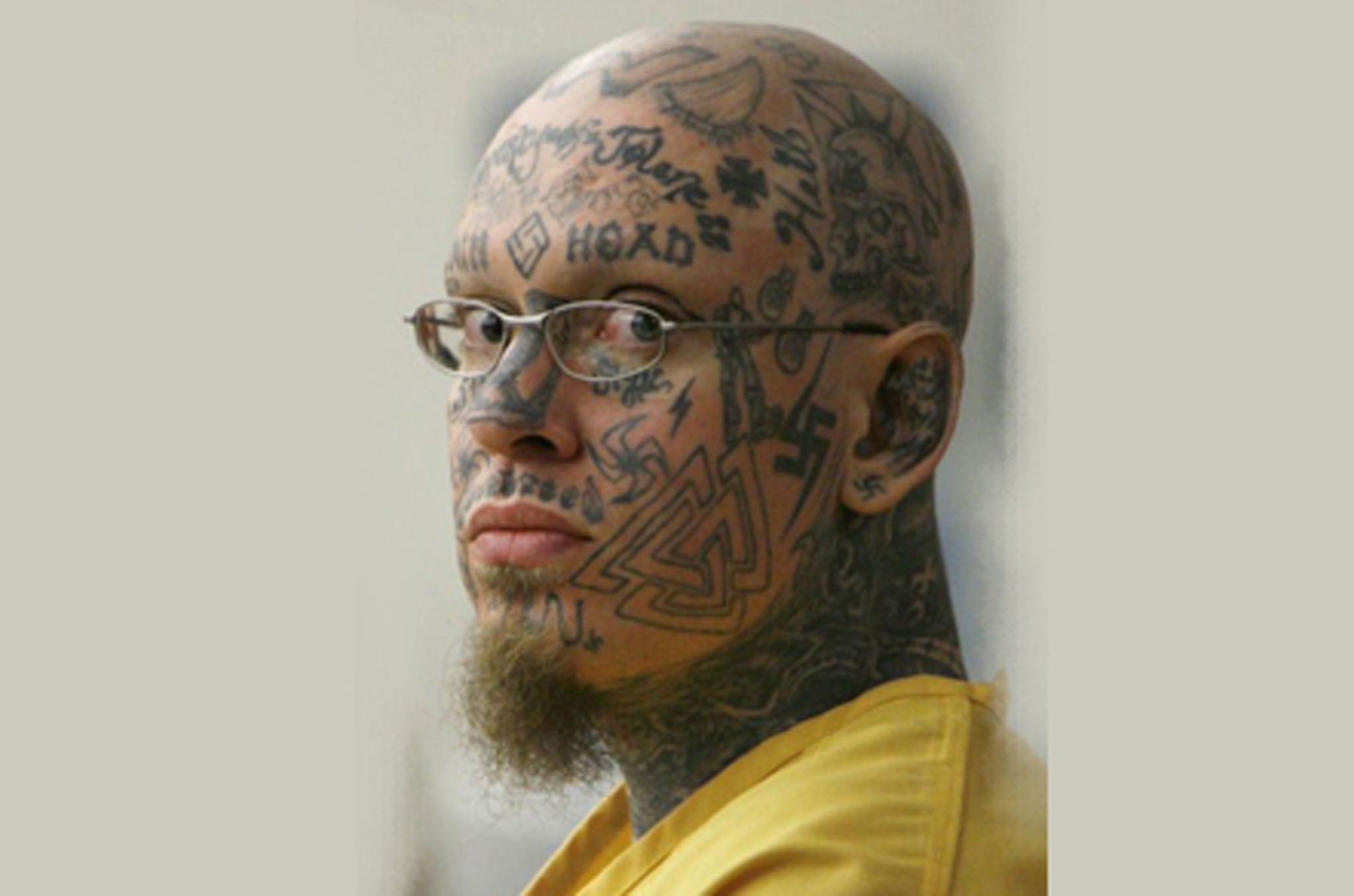 Face tattooed neo nazi is sentenced to life for the for Tn tattoo laws