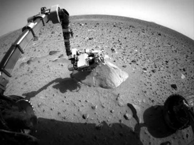Nasa's Mars Rover Spirit took the first picture from Spirit since problems with communications began a week earlier. The image shows the robotic arm extended to the rock called Adirondack