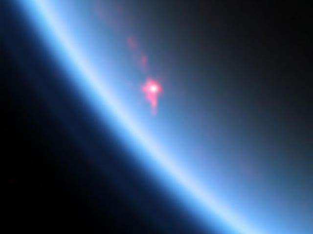 This near-infrared color image shows a specular reflection, or sunglint, off of a hydrocarbon lake named Kivu Lacus on Saturn's moon Titan