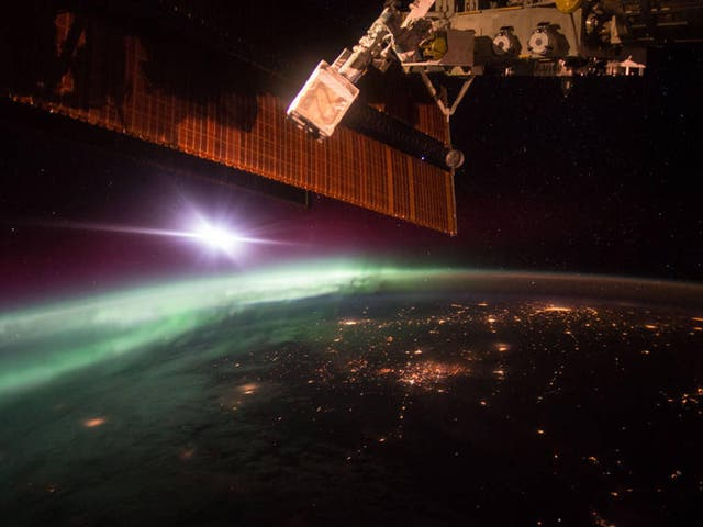 Nasa astronaut Scott Kelly captured this photograph of the green lights of the aurora from the International Space Station