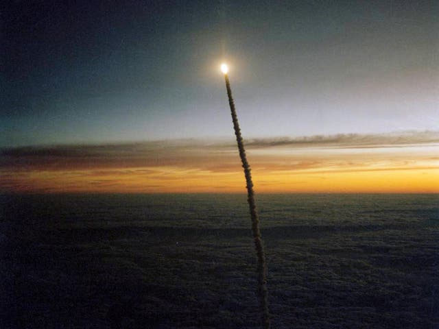 The Space Shuttle Challenger launches from Florida at dawn. On this mission, Kathryn Sullivan became the first U.S. woman to perform a spacewalk and Marc Garneau became the first Canadian in space. The crew of seven was the largest to fly on a spacecraft at that time, and STS-41G was the first flight to include two female astronauts