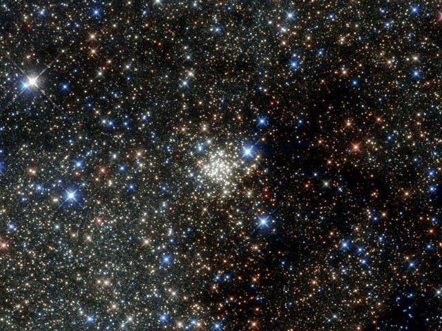 This Nasa Hubble Space Telescope image presents the Arches Cluster, the densest known star cluster in the Milky Way