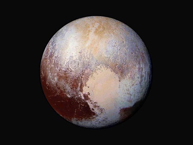 Four images from New Horizons' Long Range Reconnaissance Imager (LORRI) were combined with colour data from the Ralph instrument to create this enhanced colour global view of Pluto