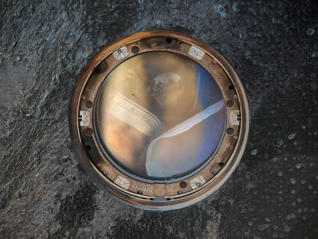 A sokol suit helmet can be seen against the window of the Soyuz TMA-11M capsule shortly after the spacecraft landed with Expedition 39 Commander Koichi Wakata of the Japan Aerospace Exploration Agency (JAXA), Soyuz Commander Mikhail Tyurin of Roscosmos, and Flight Engineer Rick Mastracchio of NASA near the town of Zhezkazgan, Kazakhstan