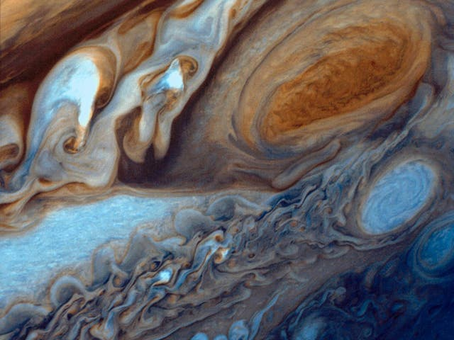 Jupiter is the largest planet in the solar system and perhaps the most majestic. Vibrant bands of clouds carried by winds that can exceed 400 mph continuously circle the planet's atmosphere