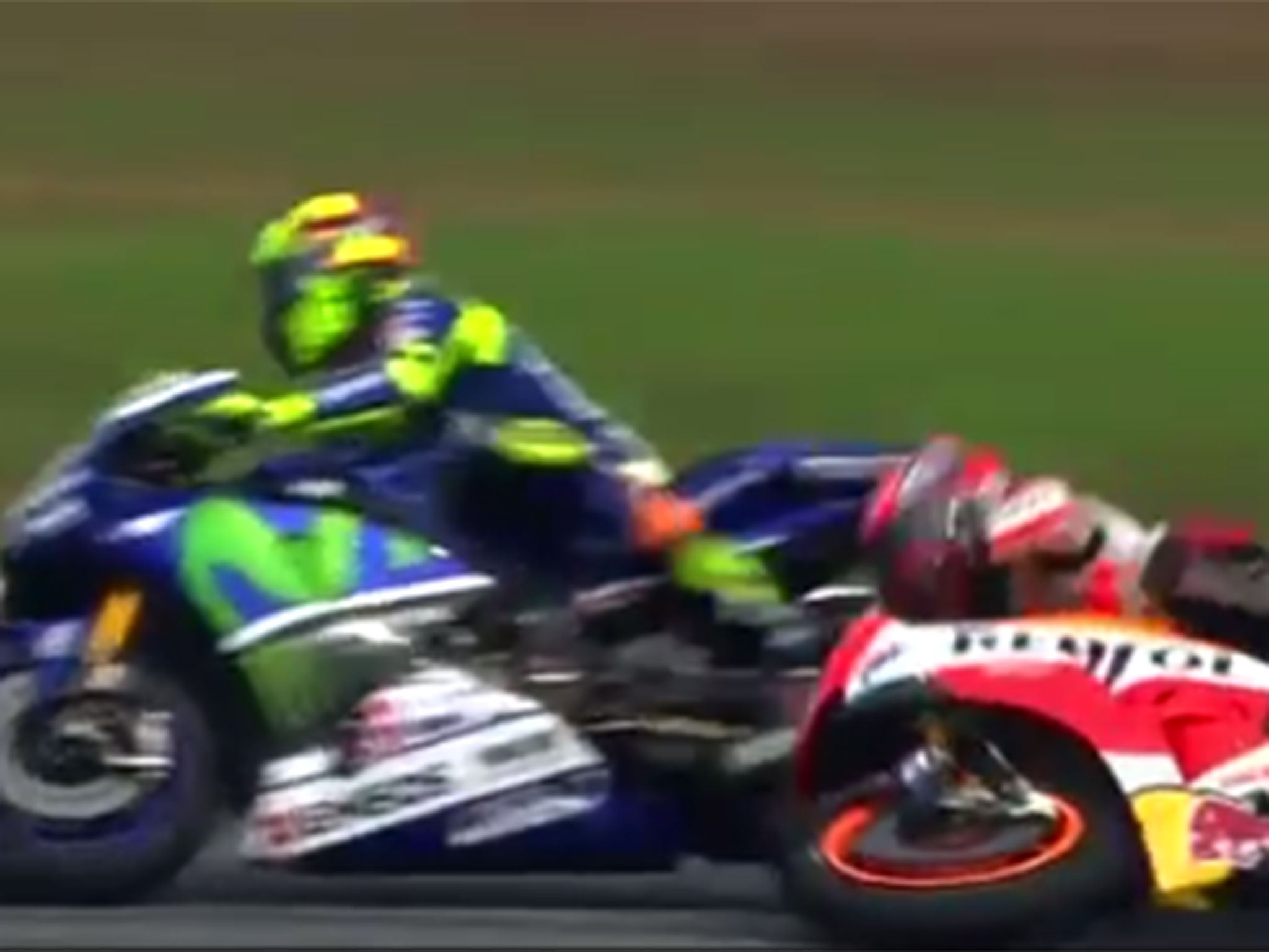 Valentino Rossi 'kicks' Marc Marquez from bike causing crash at MotoGP Malaysian Grand Prix ...
