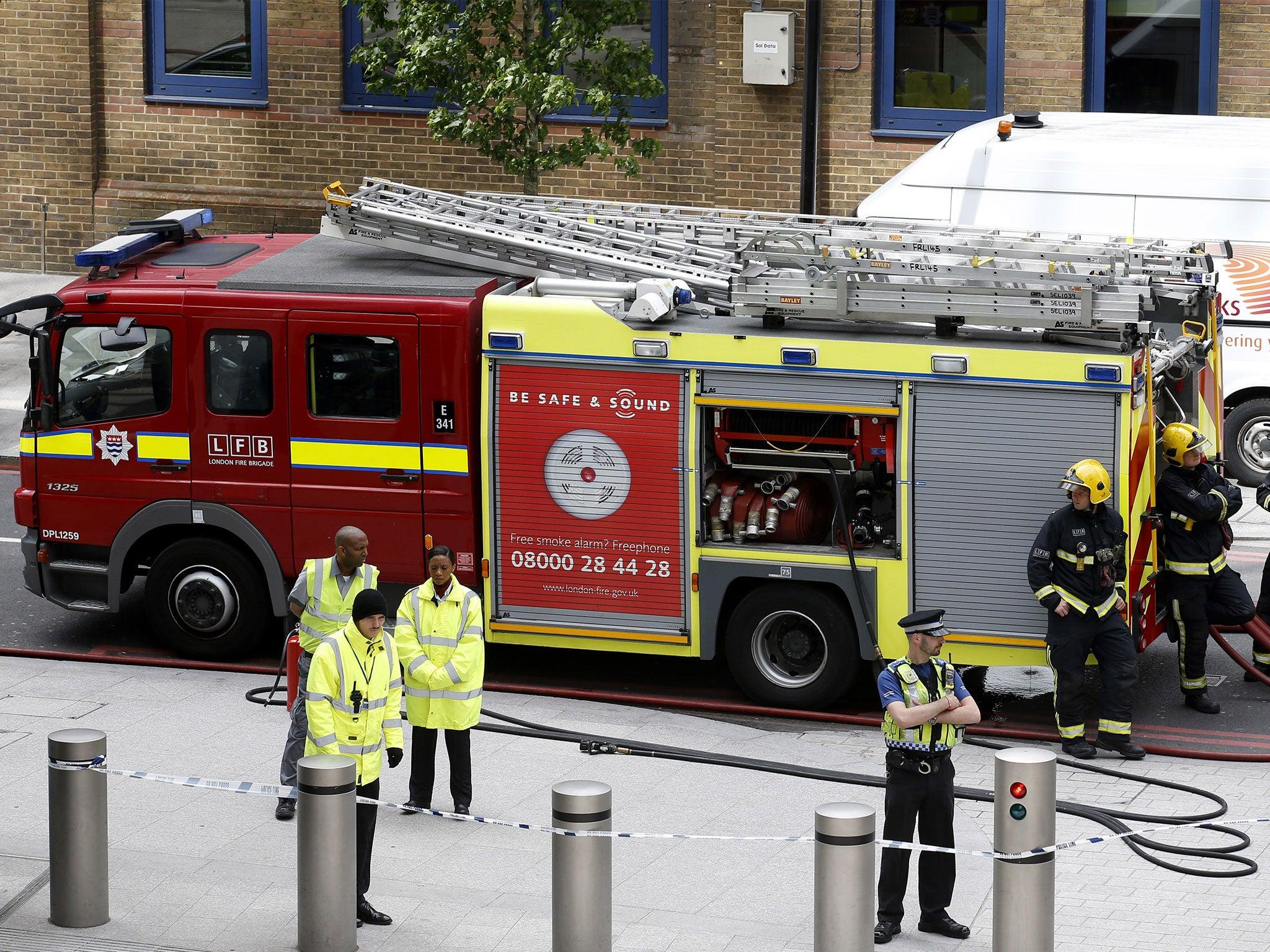 Nearly 100 people flee tower block fire in East London