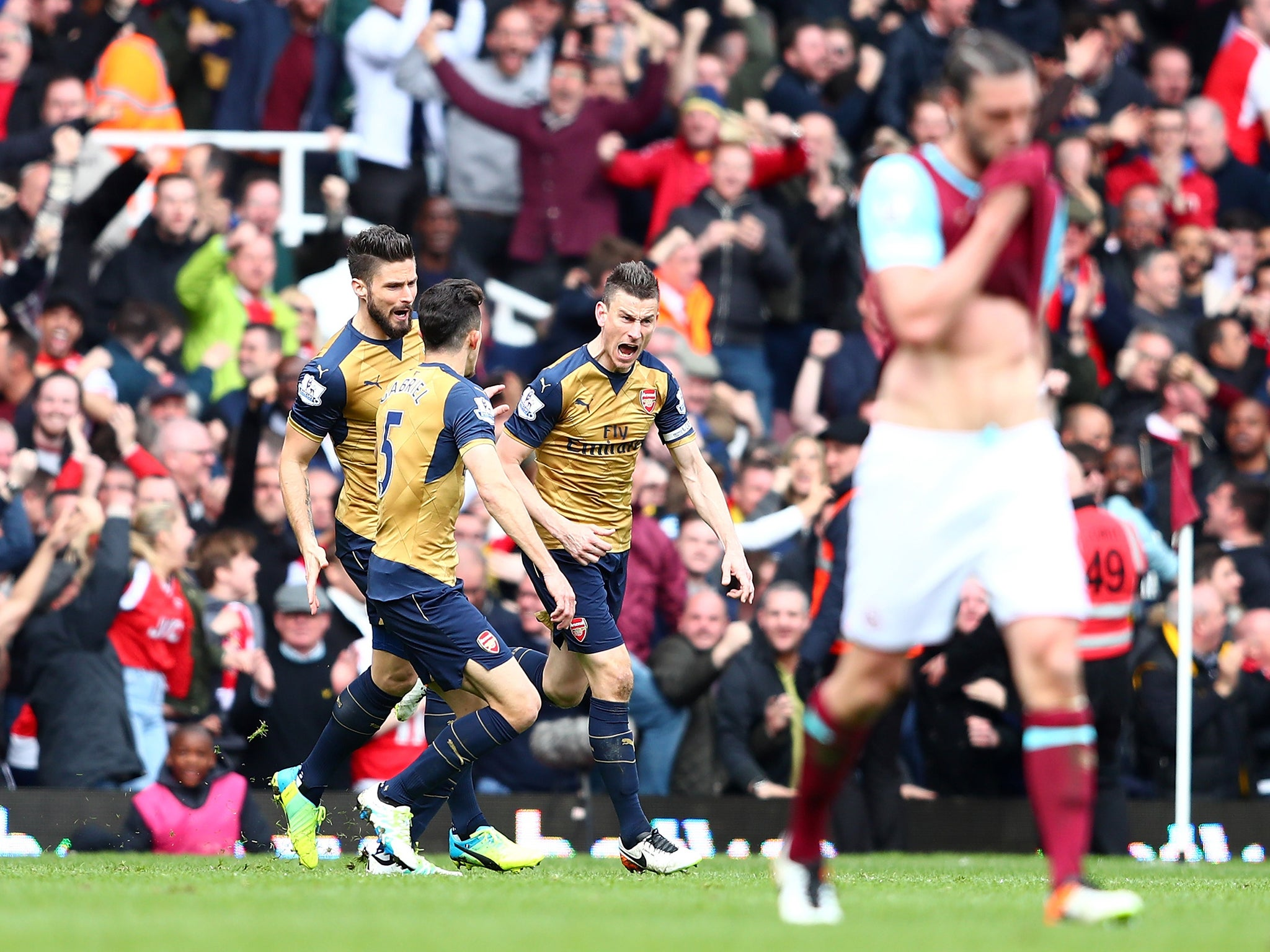 West Ham vs Arsenal match report: Andy Carroll scores hat-trick but Laurent Koscielny earns Gunners a point