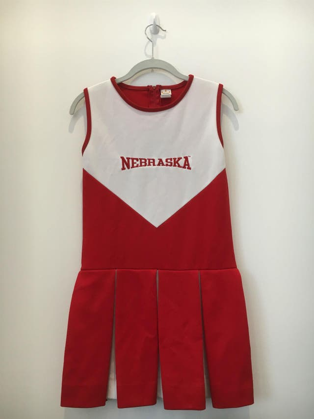 """A vintage cheerleadering uniform, bought as a turn-on for its owner's boyfriend, who was a fan of the Cornhuskers, the University of Nebraska's football team. """"The night he ended things I almost put the uniform on in anticipation of him getting home,"""" she writes, """"but thankfully opted for a flannel PJ set instead."""""""