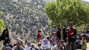 Isis conquered the Kurdish towns of Sinjar and Zumar in August 2014, forcing thousands of civilians to flee their homes. Pictured are a group of Yazidi Kurds who have fled