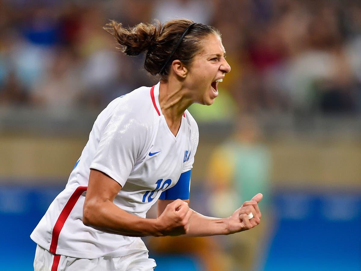 Who is  retiring Team USA striker Carli Lloyd?
