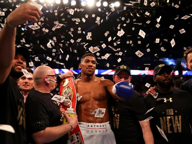 Charles Martin hit the canvas twice as Joshua cruises through to claim the IBF world heavyweight title.