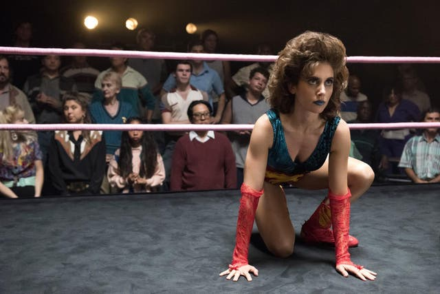 """Mad Men's Alison Brie is our entry point into this comedy-drama inspired by a real life all-female wrestling league in the Eighties. Ruth Wilder (Brie) is a down-on-her luck actor who, out of desperation, signs up a wrestling competition willed into being by Sam Sylvia (podcast king Marc Maron). Britrock singer Kate Nash is one of her her fellow troupe members: the larger than life Rhonda """"Britannica"""" Richardson."""