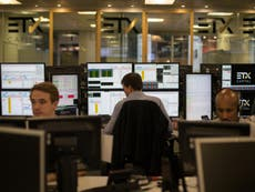 FTSE 100 recovers some losses as European and US markets also settle down, Asian stocks trade mixed
