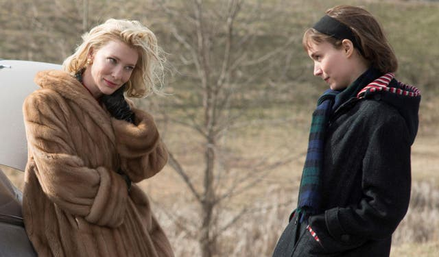 """A film that finds its eroticism in small gestures - in the languid rest of a glove, in a glance, shared across a crowded room - when it comes to director Todd Haynes actually filming the first time Therese (Rooney Mara) and Carol (Cate Blanchett) have sex, their chemistry is already so palpable that the moment feels nothing short of explosive.   """"It's very much like shooting a musical number,"""" Haynes told E!News of the scene. """"You start the music and basically you just go and the camera finds the moments and the beats. And we had some amazing material with these two women to work with."""""""