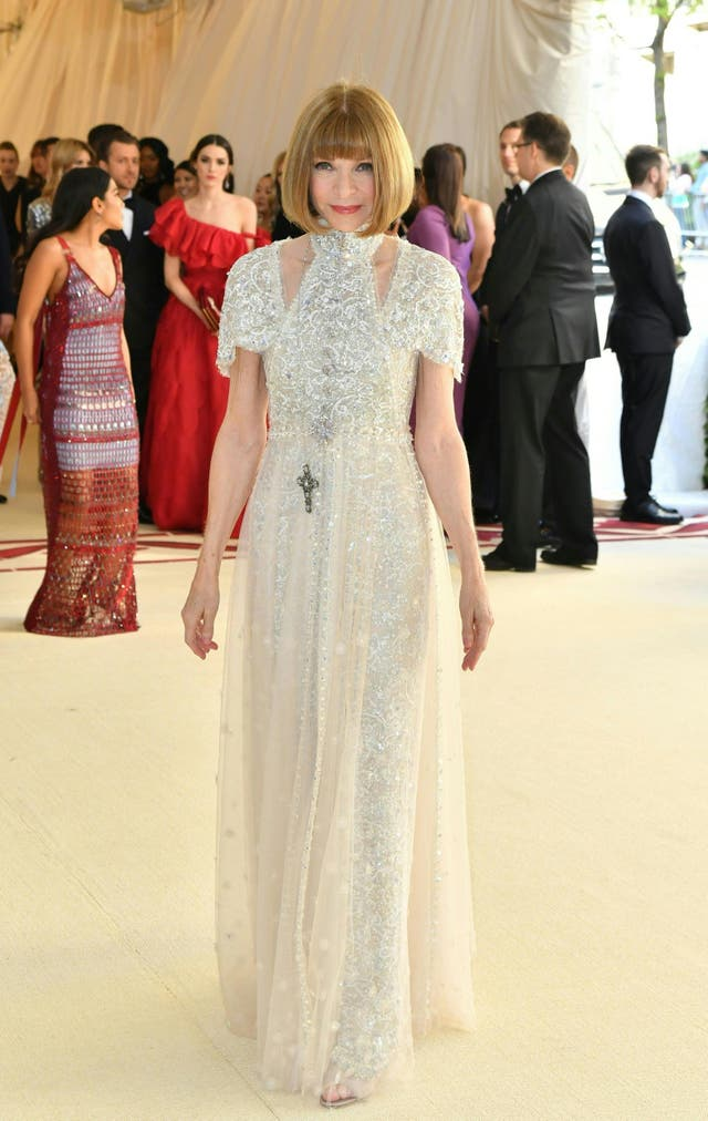 Vogue editor Anna Wintour wears a custom Chanel gown featuring a halter neck and intricate beading
