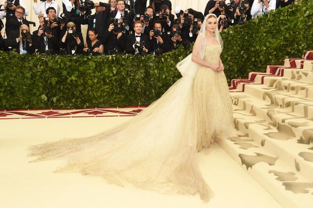 Kate Bosworth wears an ethereal Oscar de la Renta gown topped with a mantilla veil