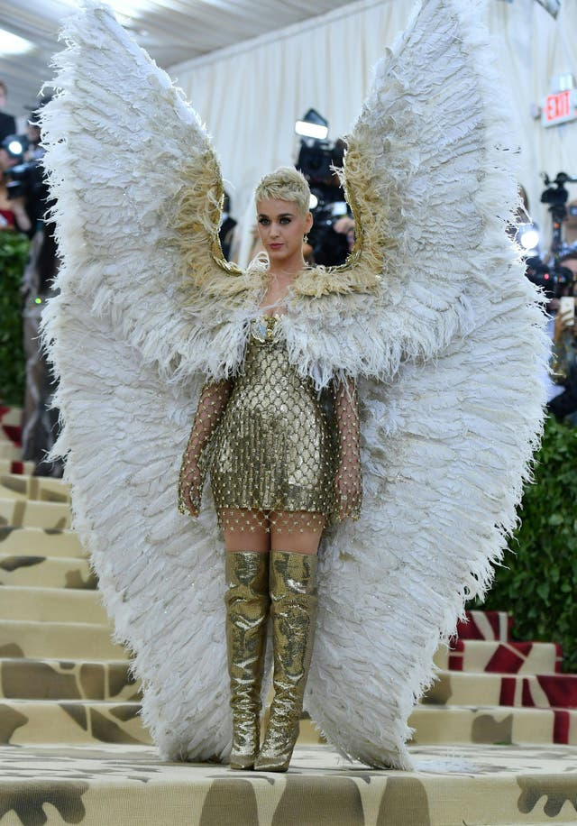 Katy Perry incorporated the theme with oversized wings, a Versace chainmail dress and thigh high boots