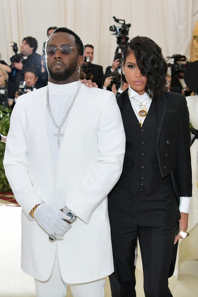 Sean 'Diddy' Combs wears a Musika Frere suit while Cassie opted for Thom Browne with Chopard earrings