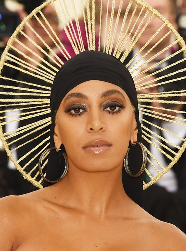 Solange Knowles opted for a structural black Iris van Herpen dress and a halo headpiece with a black du-rag