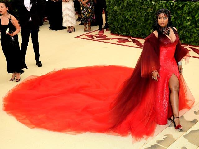 Nicki Minaj wears a red Oscar de la Renta gown and bejeweled headpiece