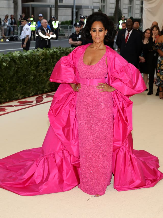 Tracee Ellis Ross wears a bright pink gown with a matching jacket by Michael Kors