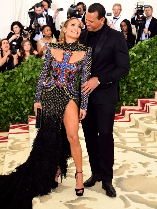 Jennifer Lopez wears a bejewelled Balmain gown with cross detailing while Alex Rodriguez opted for a polished black suit