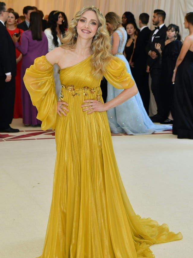 Amanda Seyfried wears a romantic Renaissance-style gown by Prada
