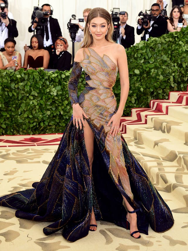 Supermodel Gigi Hadid wears a Versace gown with stain glass window-inspired detail