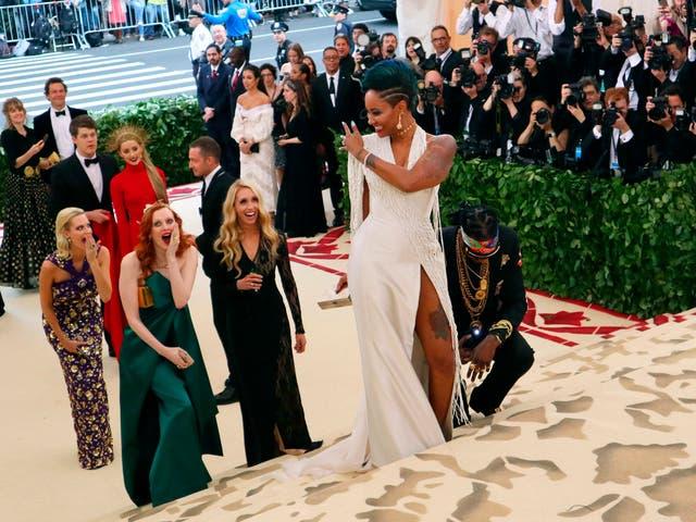 2 Chainz (kneeling) proposed to Kesha Ward on the red carpet, both wearing custom Versace