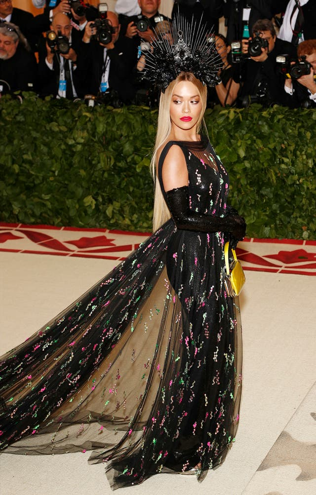 Rita Ora wears an all-black embellished ensemble by Prada
