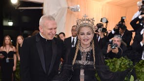 Madonna poses alongside Jean Paul Gaultier, the designer of her gothic Met Gala gown
