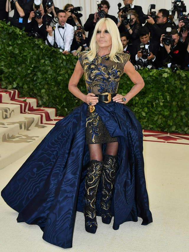 Donatella Versace, who was co-host for the event, opted for an ornate navy and gold dress of her own design