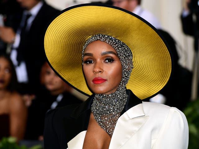 Janelle Monae wears a monochrome Marc Jacobs gown with a crystallised head wrap and Stephen Jones hat