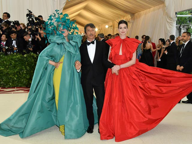 Frances McDormand wearing a Versace gown and Philip Treacy headpiece, Pierpaolo Piccioli, and Anne Hathaway sporting a Valentino Couture red ballgown