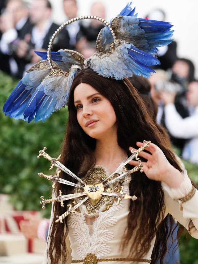 Lana Del Rey wears an elaborate Gucci gown and bird halo headpiece