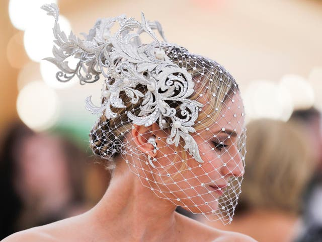 Diane Kruger accessorised her Prabal Gurung gown with a custom Philip Treacy head piece