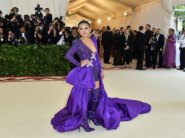 Contributing Editor of Vogue Thailand, Nichapat Suphap, wears custom Peter Dundas