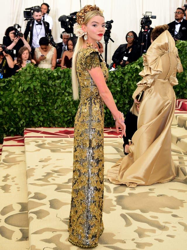 Anya Taylor-Joy wears a gold tapestry Dolce & Gabbana dress