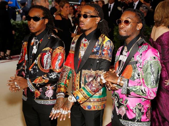 Atlanta-based trio, Migos, wear sequinned Versace suits