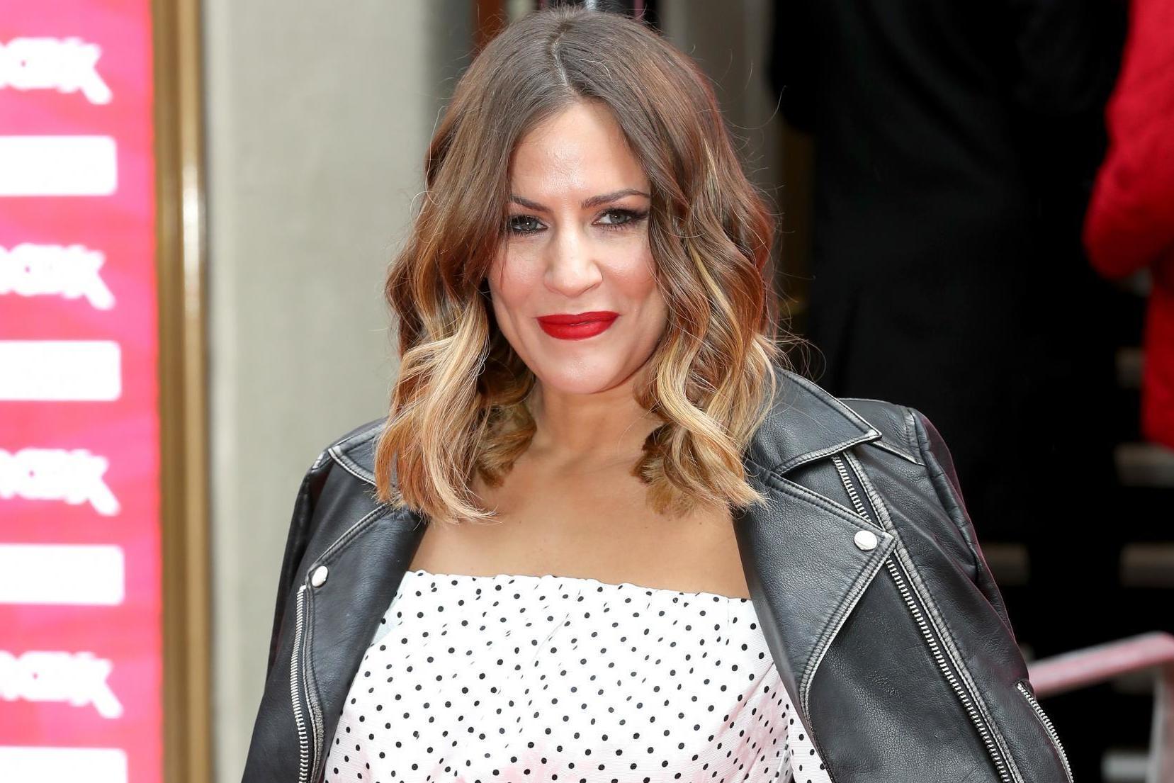 Love Island host Caroline Flack announces split from fiancé Andrew Brady